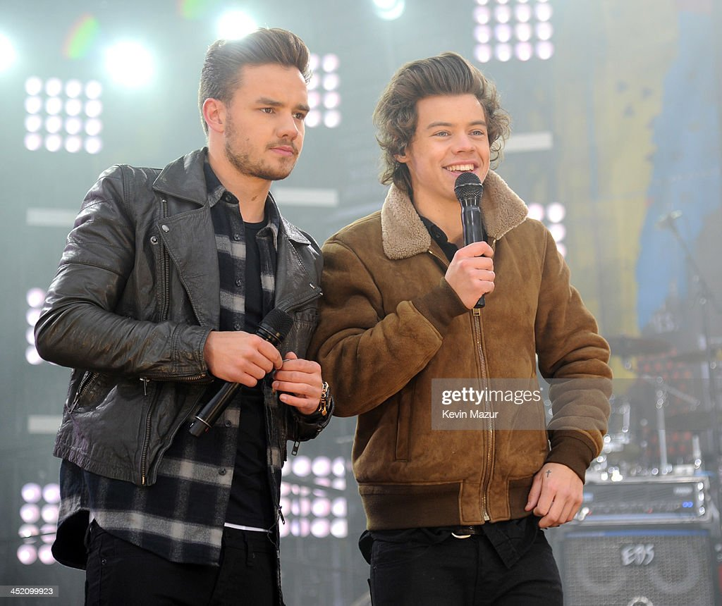 Liam Payne and Harry Styles of One Direction performs on ABC's 'Good Morning America' at Rumsey Playfield, Central Park on November 26, 2013 in New York City.