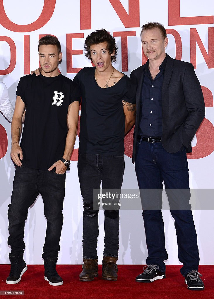 Liam Payne and Harry Styles of One Direction with Morgan Spurlock attend a photocall to launch their new film 'One Direction: This Is Us 3D' held at the Blue Sky Studios on August 19, 2013 in London, England.