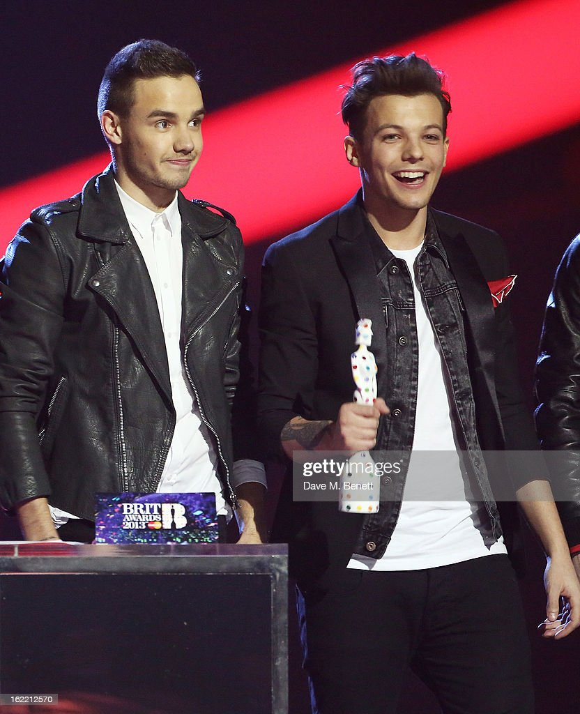 Liam Payne (L) and Louis Tomlinson of One Direction are presented with the Global Success award on stage at the Brit Awards at 02 Arena on February 20, 2013 in London, England.