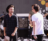 Liam Payne and Louis Tomlinson of One Direction perform on ABC's 'Good Morning America' at Rumsey Playfield Central Park on August 4 2015 in New York...