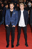 Liam Payne and Niall Horan of 'One Direction' arrive at the 16th NRJ Music Awards at Palais des Festivals on December 13 2014 in Cannes France