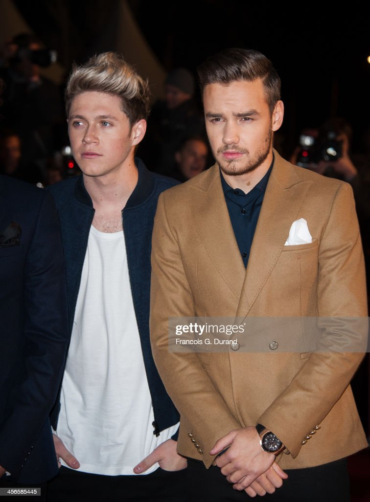 Liam Payne (R) and Niall Horan of One Direction attend the 15th NRJ Music Awards at Palais des Festivals on December 14, 2013 in Cannes, France.