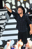 Liam Payne and One Direction perform on ABC's 'Good Morning America' at Rumsey Playfield Central Park on August 4 2015 in New York City