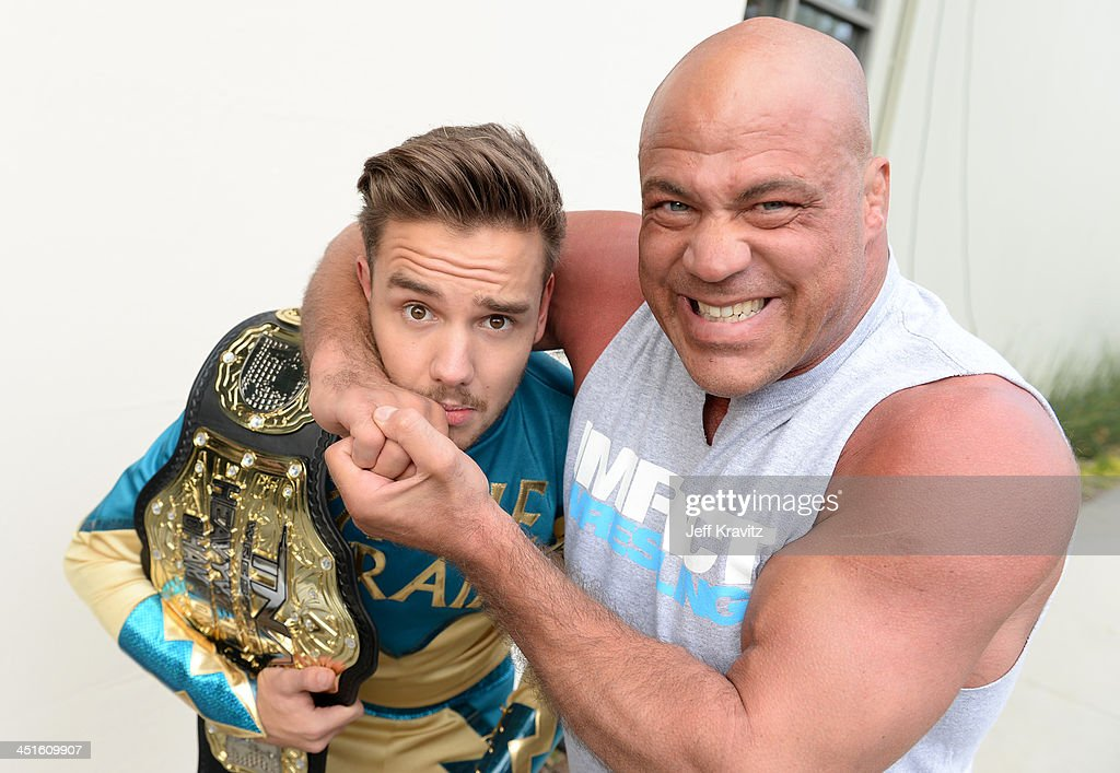 <a gi-track='captionPersonalityLinkClicked' href=/galleries/search?phrase=Liam+Payne&family=editorial&specificpeople=7235152 ng-click='$event.stopPropagation()'>Liam Payne</a> (L) and pro wrestler <a gi-track='captionPersonalityLinkClicked' href=/galleries/search?phrase=Kurt+Angle&family=editorial&specificpeople=644134 ng-click='$event.stopPropagation()'>Kurt Angle</a> during One Direction celebrates 1D Day at YouTube Space LA, a 7-hour livestream event broadcast exclusively on YouTube and Google+. Featuring behind the scenes footage, Guinness world record attempts, and amazing special guests, the global event also marked the premiere of tracks from their new album 'Midnight Memories', set for release November 25th, in Playa Vista, California on November 23, 2013