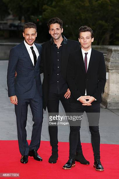 Liam Payne Ben Haenow and Louis Tomlinson attend the Believe in Magic Cinderella Ball at the Natural History Museum on August 10 2015 in London...