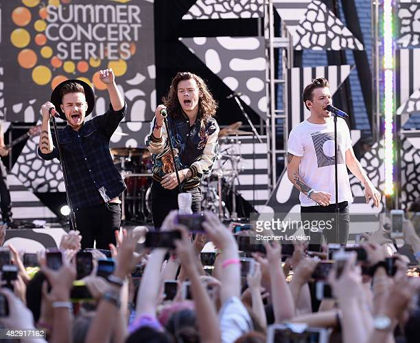 Liam Payne Harry Styles and Louis Tomlinson of One Direction perform on ABC's 'Good Morning America' at Rumsey Playfield Central Park on August 4...