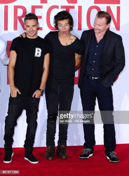 Liam Payne Harry Styles from One Direction with Morgan Spurlock are seen at a photocall to promote their new film This Is Us at the Sky Studios London