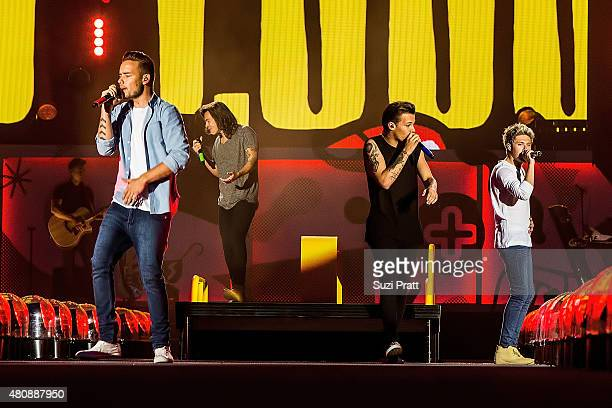 Liam Payne Harry Styles Louis Tomlinson and Niall Horan of One Direction perform at CenturyLink Field on July 15 2015 in Seattle Washington