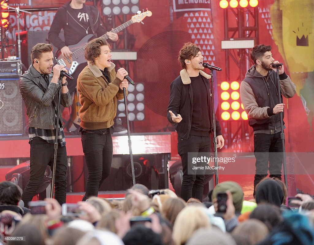 Liam Payne, Harry Styles, Louis Tomlinson and Zayn Malik of One Direction perform at Rumsey Playfield on November 26, 2013 in New York City.