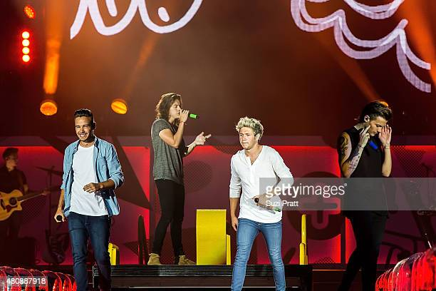 Liam Payne Harry Styles Niall Horan and Louis Tomlinson of One Direction perform at CenturyLink Field on July 15 2015 in Seattle Washington