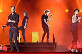 Liam Payne Harry Styles Niall Horan and Louis Tomlinson of One Direction perform at Soldier Field on August 23 2015 in Chicago Illinois