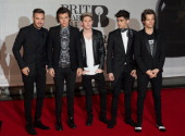 Liam Payne Harry Styles Niall Horan and Zayn Malik and Louis Tomlinson of One Direction attend The BRIT Awards 2014 at 02 Arena on February 19 2014...