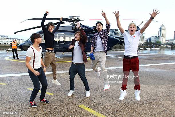 LR Liam Payne Louis Tomlinson Harry Styles Zain Malik and Niall Horan of One Direction travel in a luxury helicopter to Glasgow Manchester and London...