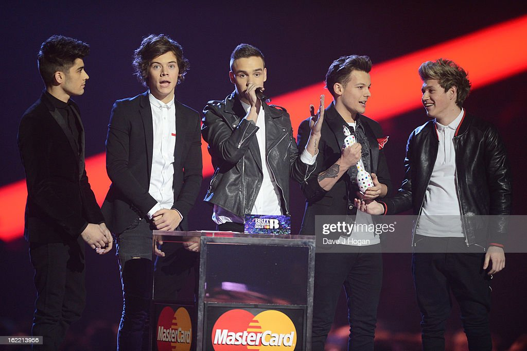 Liam Payne, Louis Tomlinson, Zayn Malik, Harry Styles and Niall Horan of One Direction accept their Global Success Award at The Brit Awards 2013 at The O2 Arena on February 20, 2013 in London, England.