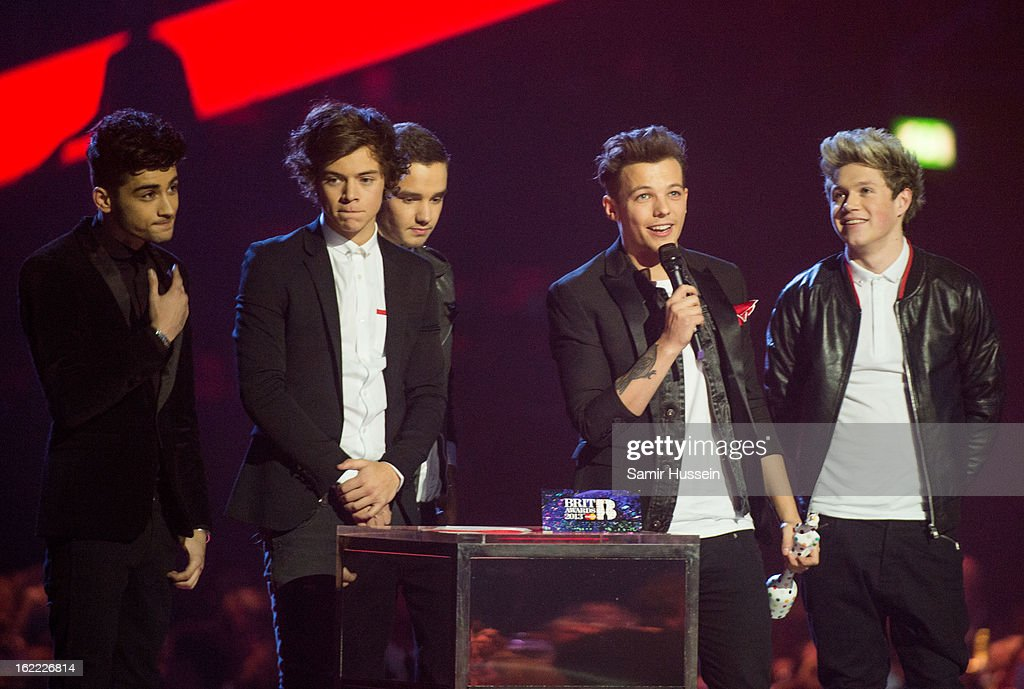 Liam Payne, Louis Tomlinson, Zayn Malik, Harry Styles and Niall Horan of One Direction accept their Global Success Awardduring the Brit Awards 2013 at the 02 Arena on February 20, 2013 in London, England.
