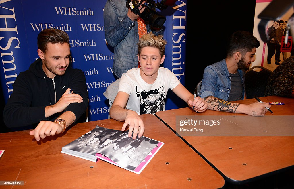 Liam Payne, Niall Horan and Zayn Malik of One Direction attend the book signing of One Direction's new book 'Where We Are' held at Alexandra Palace on November 18, 2013 in London, England.