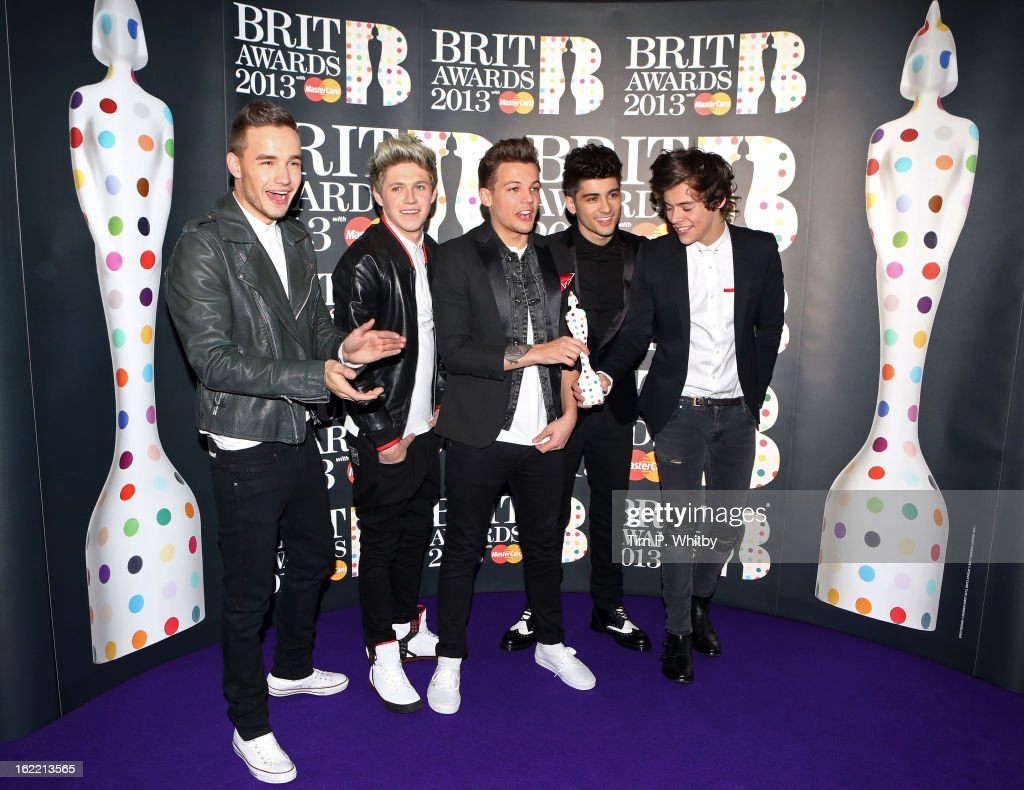 Liam Payne, Niall Horan, Louis Tomlinson, Zayn Malik and Harry Styles of One Direction pose with their Brits Global Success Award in the press room at the Brit Awards 2013 at the 02 Arena on February 20, 2013 in London, England.