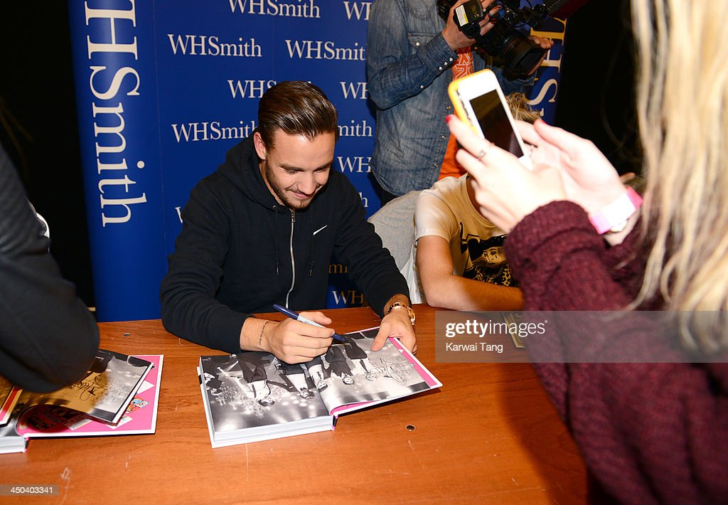 Liam Payne of One Direction attends the book signing of One Direction's new book 'Where We Are' held at Alexandra Palace on November 18, 2013 in London, England.