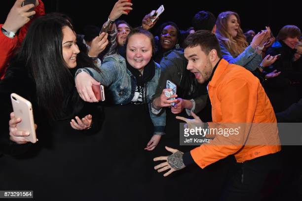 Liam Payne poses with fans attends the MTV EMAs 2017 held at The SSE Arena Wembley on November 12 2017 in London England