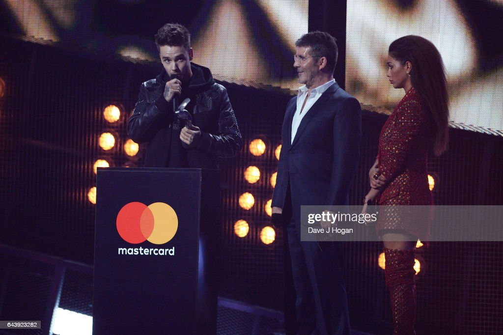 ONLY. (L) Liam Payne, Simon Cowell and Nicole Scherzinger on stage at The BRIT Awards 2017 at The O2 Arena on February 22, 2017 in London, England.