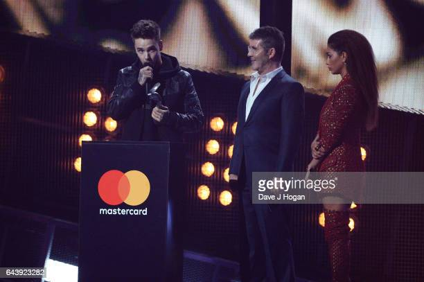 ONLY Liam Payne Simon Cowell and Nicole Scherzinger on stage at The BRIT Awards 2017 at The O2 Arena on February 22 2017 in London England