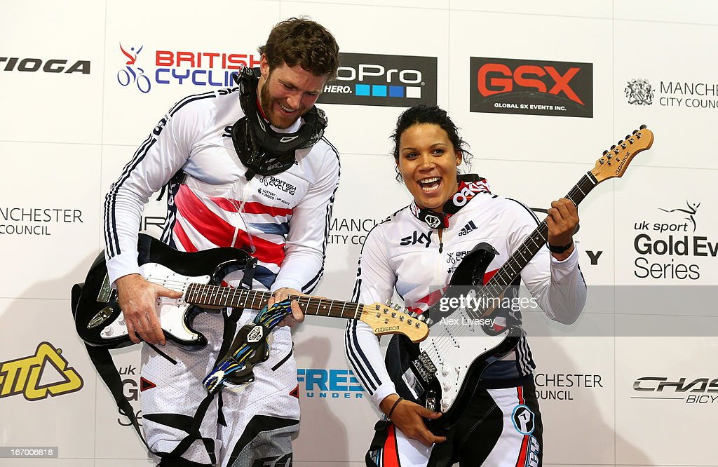Liam Phillips and Shanaze Reade of Great Britain celebrate with their prizes after winning the Men's and Women's Elite Time trials Superfinals during the UCI BMX Supercross World Cup at National Cycling Centre on April 19, 2013 in Manchester, England.