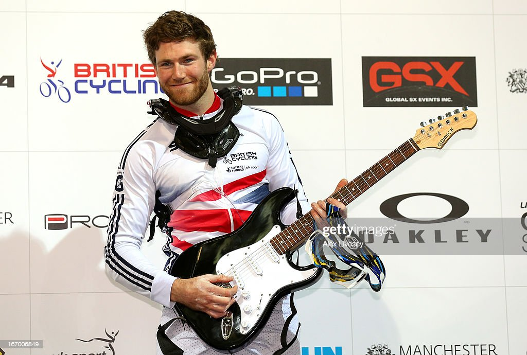 Liam Phillips of Great Britain celebrates with his prize after winning the Men's Elite Time trials Superfinal during the UCI BMX Supercross World Cup at National Cycling Centre on April 19, 2013 in Manchester, England.