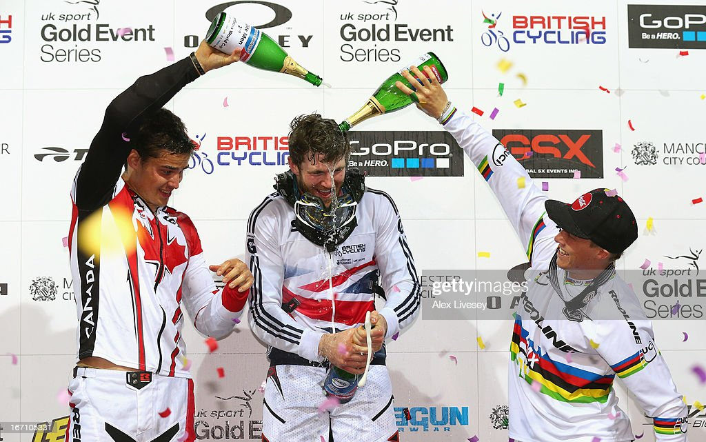 <a gi-track='captionPersonalityLinkClicked' href=/galleries/search?phrase=Liam+Phillips&family=editorial&specificpeople=5440406 ng-click='$event.stopPropagation()'>Liam Phillips</a> of Great Britain is soaked in champagne by Tory Nyhaug of Canada (l) and <a gi-track='captionPersonalityLinkClicked' href=/galleries/search?phrase=Sam+Willoughby+-+BMX+Cyclist&family=editorial&specificpeople=4894162 ng-click='$event.stopPropagation()'>Sam Willoughby</a> of Australia (r) after victory in the Men's Elite Final during the UCI BMX Supercross World Cup at the National Cycling Centre on April 20, 2013 in Manchester, England.