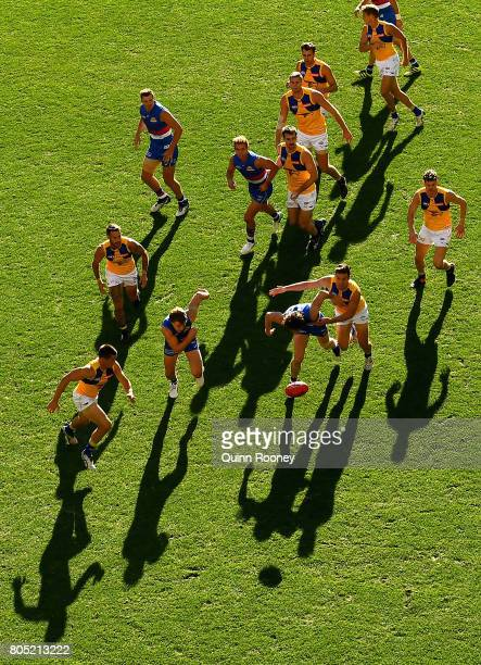 Liam Picken of the Bulldogs and Sam Butler of the Eagles compete for the ball during the round 15 AFL match between the Western Bulldogs and the West...