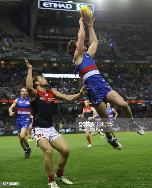 Liam Picken of the Bulldogs attempts to mark during the round 13 AFL match between the Western Bulldogs and the Melbourne Demons at Etihad Stadium on...
