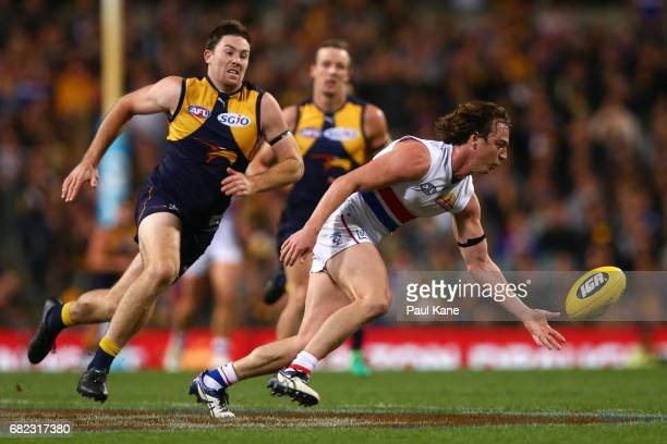 Liam Picken of the Bulldogs gathers the ball against Jeremy McGovern of the Eagles during the round eight AFL match between the West Coast Eagles and...