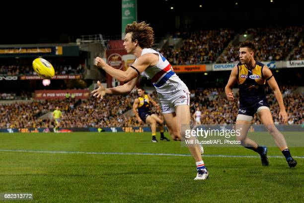 Liam Picken of the Bulldogs handpasses the ball during the round eight AFL match between the West Coast Eagles and the Western Bulldogs at Domain...
