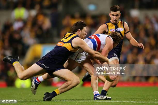 Liam Picken of the Bulldogs is tackled by Jeremy McGovern and Elliot Yeo of the Eagles during the round eight AFL match between the West Coast Eagles...