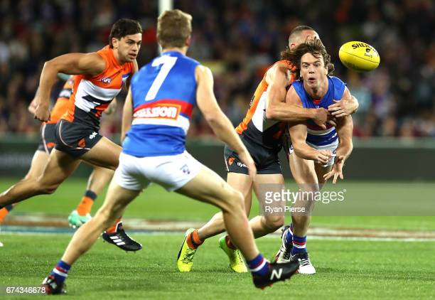 Liam Picken of the Bulldogs is tackled by Tom Scully of the Giants during the round six AFL match between the Greater Western Sydney Giants and the...