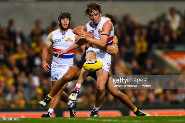 Liam Picken of the Bulldogs is tackled on a kick during the 2017 AFL round 08 match between the West Coast Eagles and the Western Bulldogs at Domain...