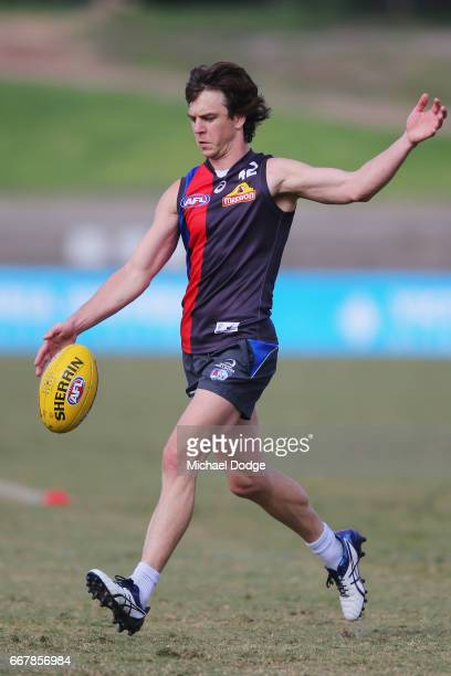 Liam Picken of the Bulldogs kicks the ball during a Western Bulldogs AFL training session at Whitten Oval on April 13 2017 in Melbourne Australia
