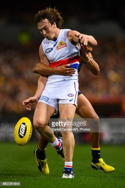 Liam Picken of the Bulldogs kicks the ball under pressure during the 2017 AFL round 08 match between the West Coast Eagles and the Western Bulldogs...