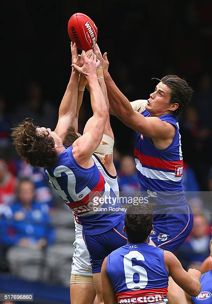 Liam Picken of the Bulldogs Lee Spurr of the Dockers and Tom Boyd of the Bulldogs compete for a mark during the round one AFL match between the...