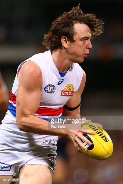 Liam Picken of the Bulldogs looks to pass the ball during the round eight AFL match between the West Coast Eagles and the Western Bulldogs at Domain...