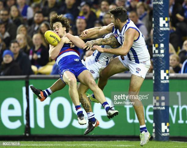 Liam Picken of the Bulldogs marks infront of Marley Williams and Jarrad Waite of the Kangaroos during the round 14 AFL match between the Western...