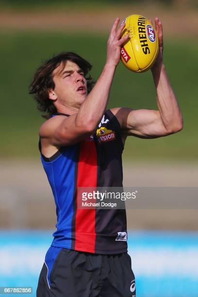 Liam Picken of the Bulldogs marks the ball during a Western Bulldogs AFL training session at Whitten Oval on April 13 2017 in Melbourne Australia