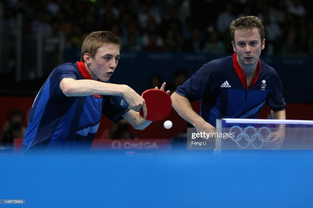 Liam Pitchford and Andrew Baggaley of Great Britain complete during Men's Team Table Tennis first round match against team of Portugal on Day 7 of the London 2012 Olympic Games at ExCeL on August 3, 2012 in London, England.