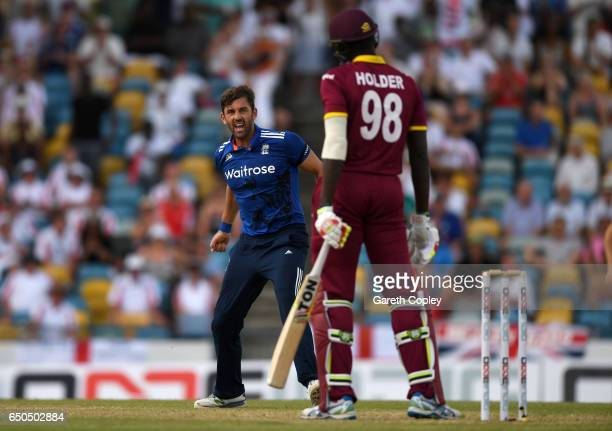Liam Plunkett of England celebrates dismissing Jason Holder of the West Indies during the 3rd One Day International between the West Indies and...