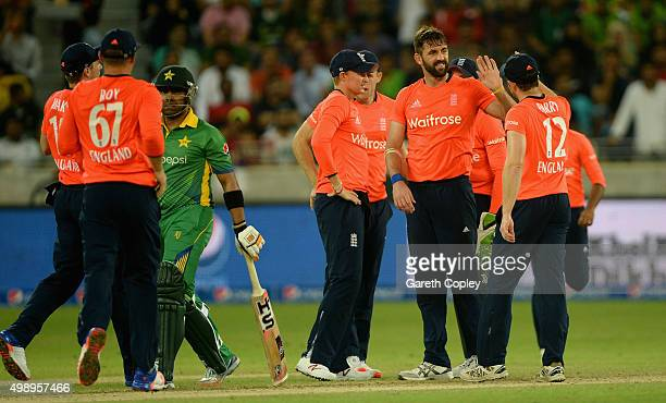 Liam Plunkett of England celebrates dismissing Umar Akmal of Pakistan during the 2nd International T20 between Pakistan and England at Dubai Cricket...