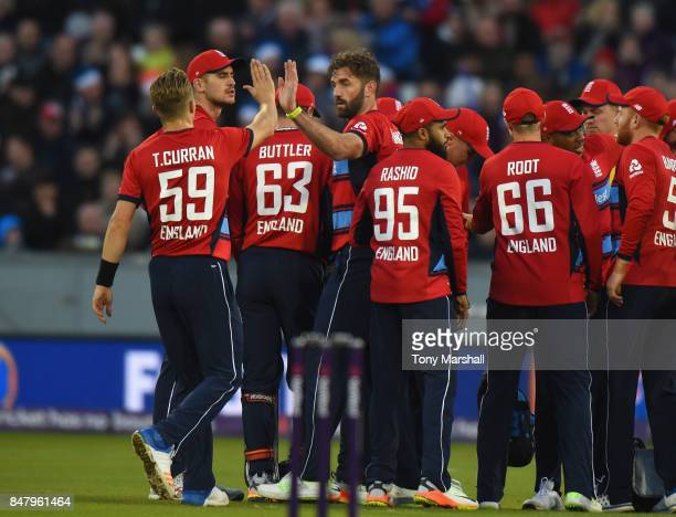 Liam Plunkett of England celebrates taking the wicket of Chris Gayle of West Indies during the 1st NatWest T20 International between England and West...