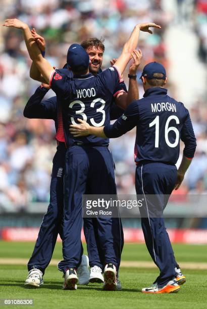 Liam Plunkett of England celebrates the wicket of Imrul Kayes of Bangladesh with Mark Wood during the ICC Champions trophy cricket match between...