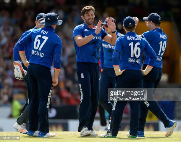 Liam Plunkett of England celebrates the wicket of Jason Mohammed during the 3rd One Day International between the West Indies and England at...