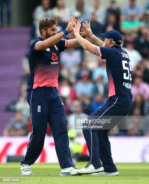 Liam Plunkett of England celebrates with Ben Stokes after taking the wicket of South Africa's AB de Villiers during the Royal London ODI match...