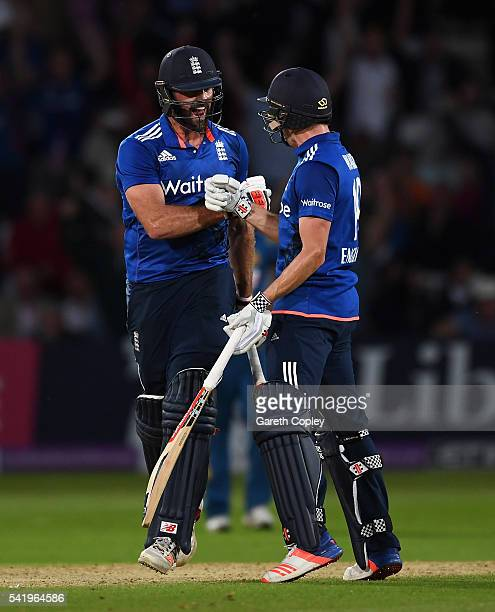 Liam Plunkett of England celebrates with Chris Woakes after hitting six runs from the final ball to tie the 1st ODI Royal London One Day match...
