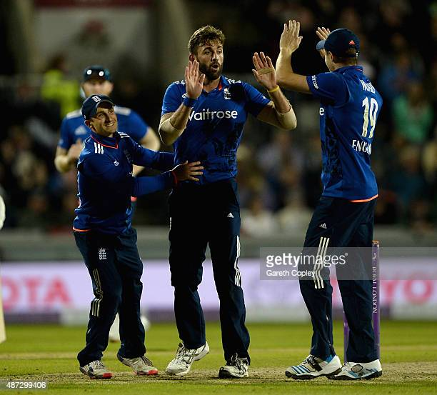 Liam Plunkett of England celebrates with James Taylor and Chris Woakes after dismissing Pat Cummins of Australia during the 3rd Royal London OneDay...